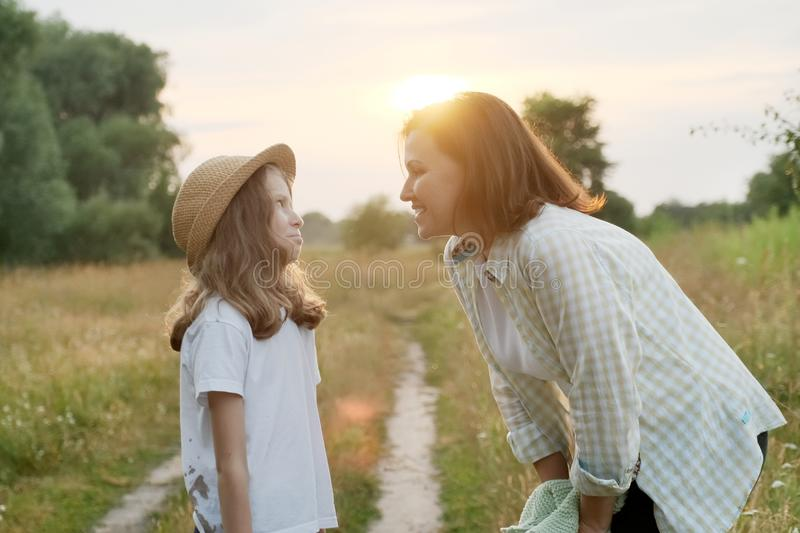 Smiling mother talking with child daughter, summer nature royalty free stock photos