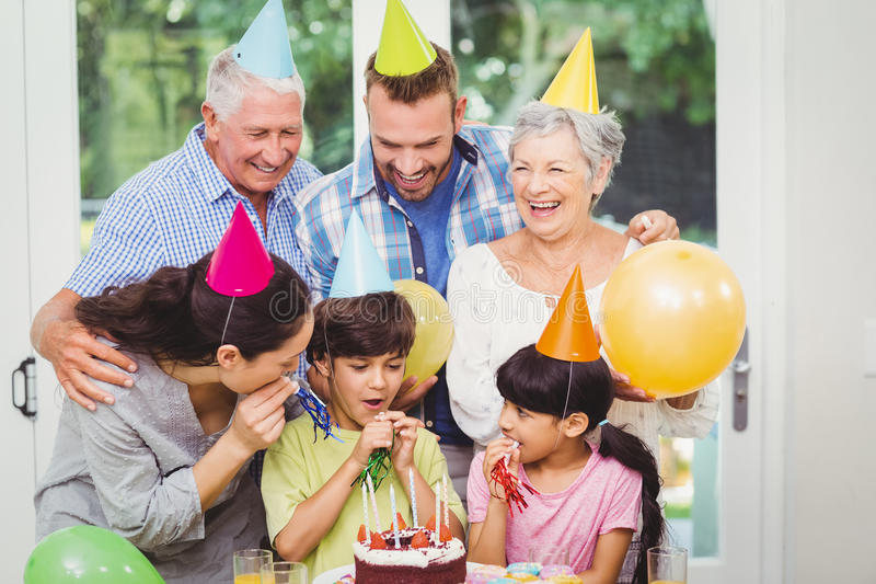 Smiling multi generation family during birthday party. At home royalty free stock photo