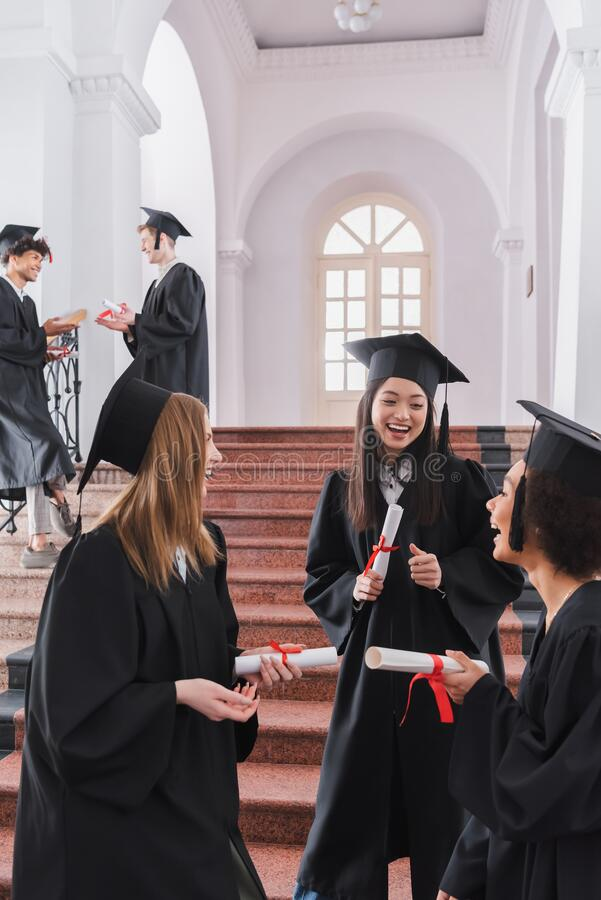 Free Smiling Multiethnic Students With Diplomas Talking Royalty Free Stock Images - 217198999