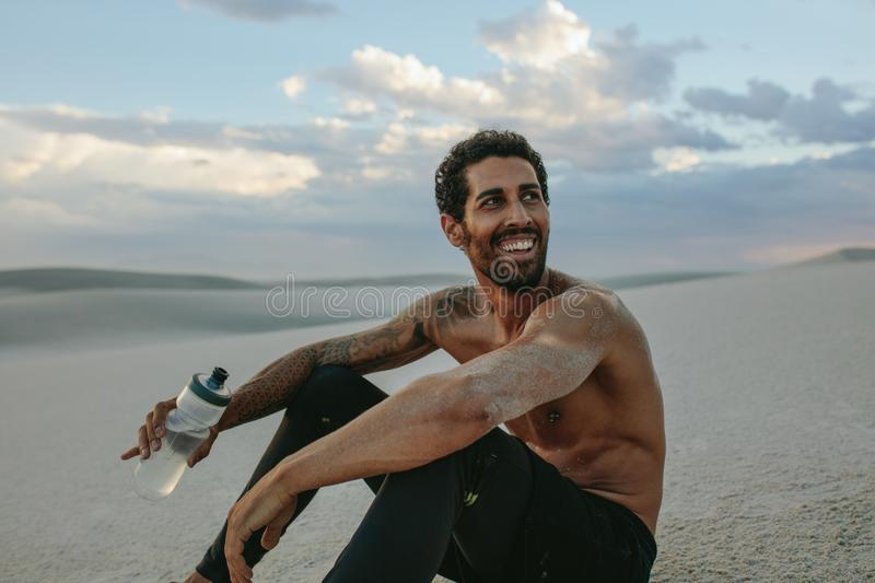 Man in desert after physical training session stock photo