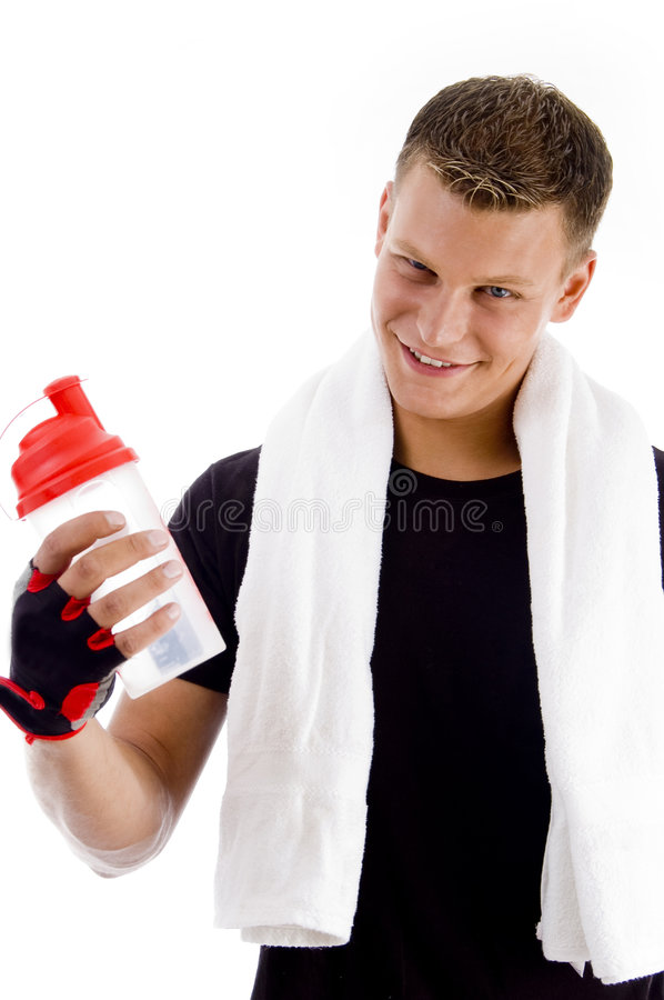 Smiling muscular man with water bottle stock images