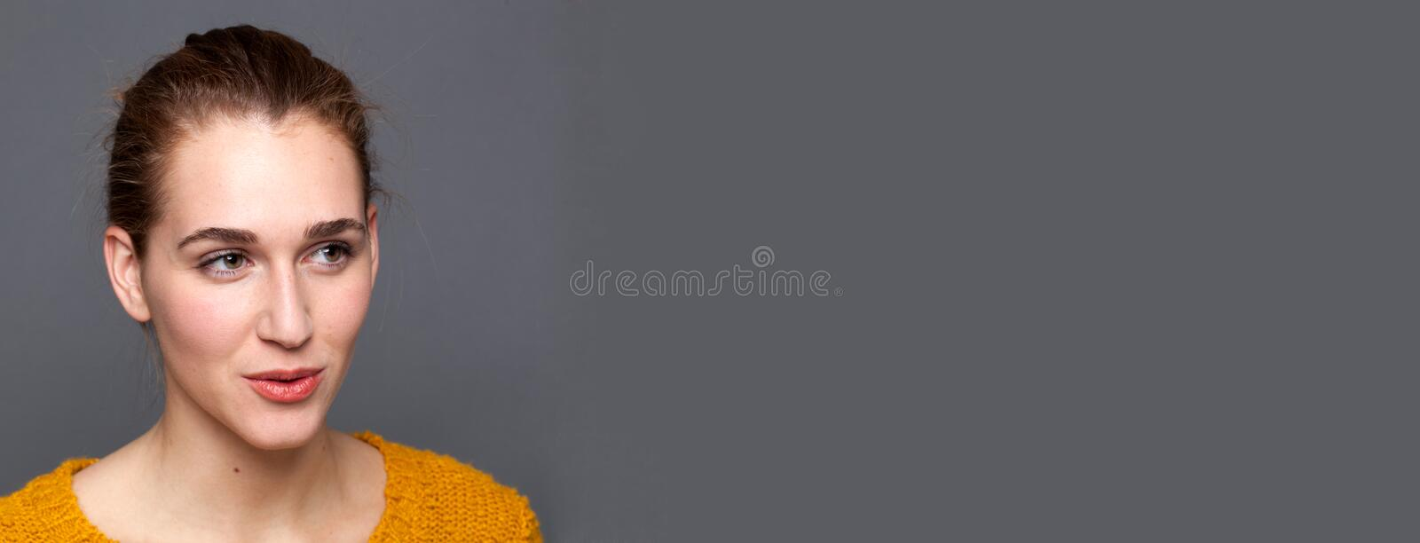 Smiling, natural beautiful girl expressing emotions of happiness and wellness royalty free stock photo