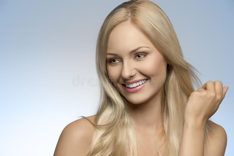Smiling natural blonde girl stock photography