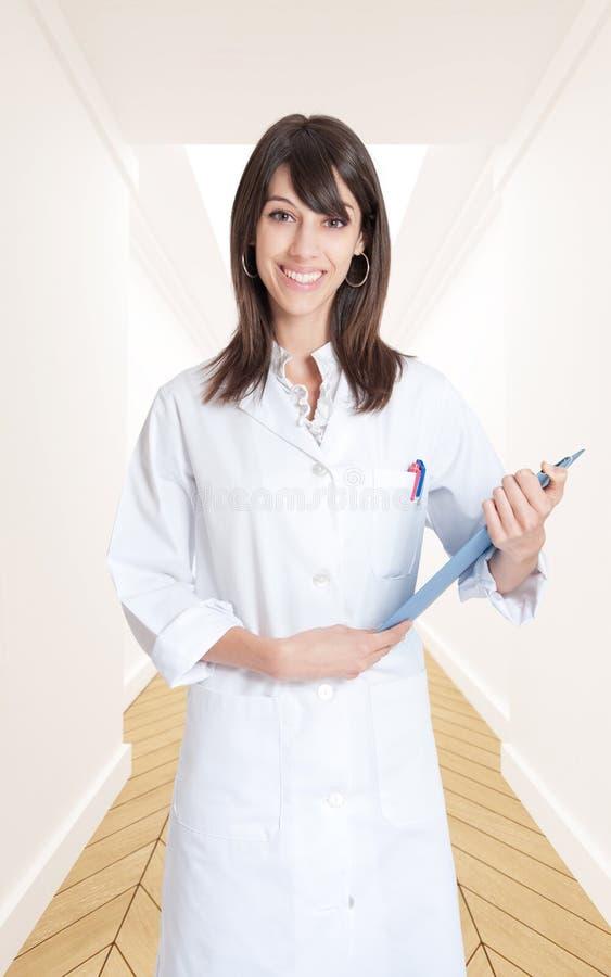 Download Smiling Nurse In A Corridor Stock Photo - Image: 22426752