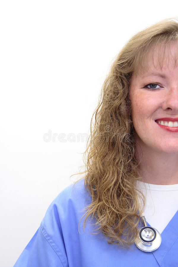 Smiling nurse with stethoscope and scrubs. Nurse with long blonde, hair wearing a stethoscope and scrubs. Photo intentionally taken of only half her face royalty free stock images