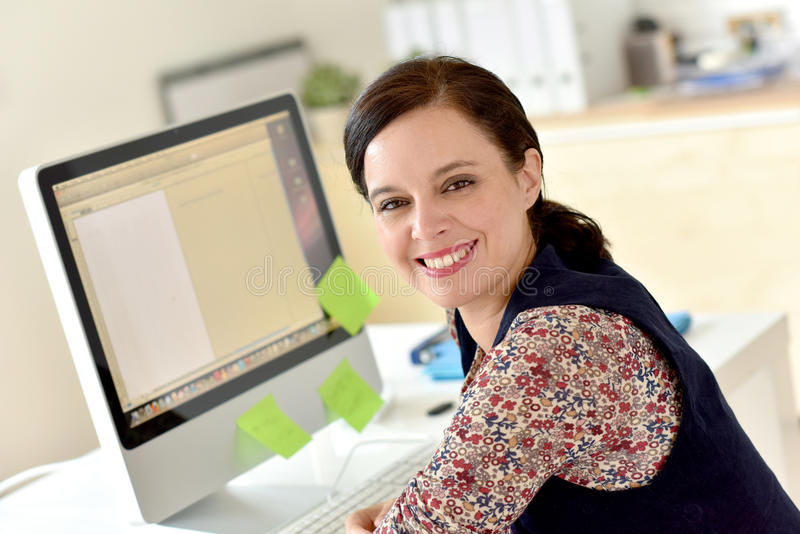 Smiling office-worker stock image