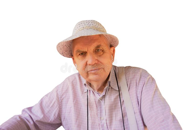Smiling old man in funny hat and ear phones portrait on isolated background. Happy elder senior gentleman or farmer or traveler stock photo