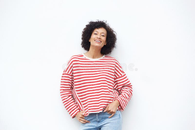 Smiling older african american woman against white background stock photography