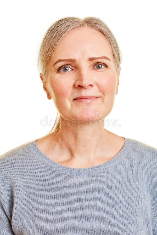 Smiling older woman from the front stock images