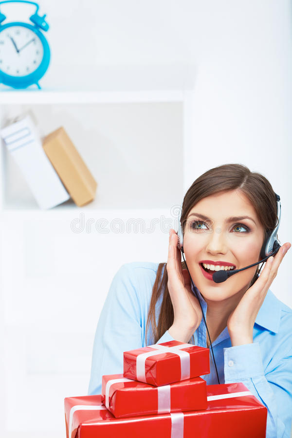 Download Smiling Operator Seat At Table With Red Gift Box. Stock Image - Image: 43454629