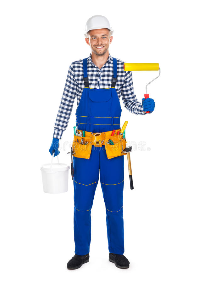 Smiling painter with paint roller and bucket isolated on white b royalty free stock photography
