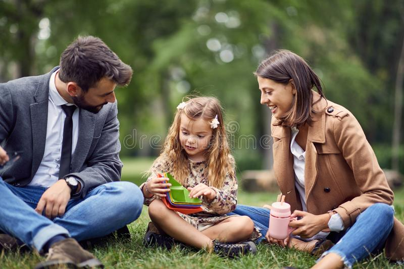 Smiling parent having fun with there little schoolgirl stock image