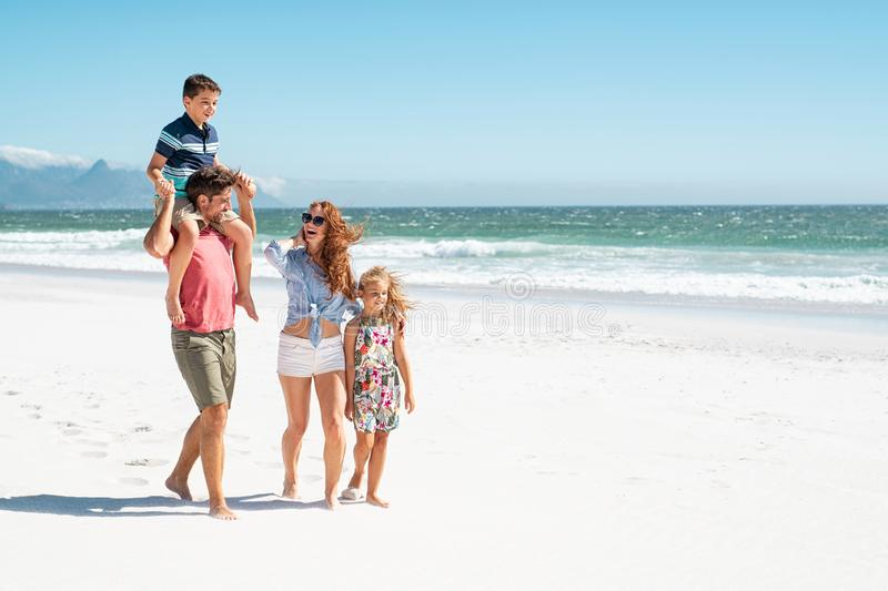 Family walking at beach royalty free stock images