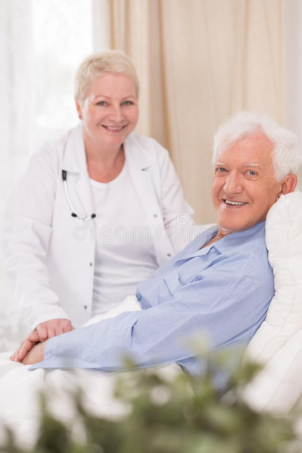 Smiling patient of geriatric ward. Photo of smiling male patient of geriatric ward stock photos