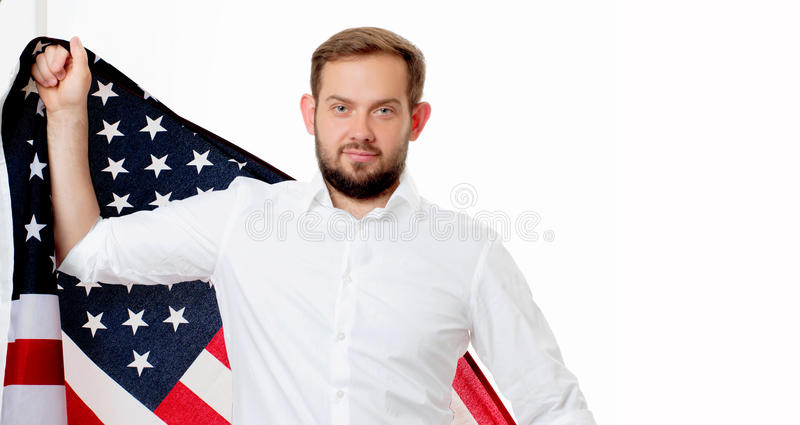 Smiling patriotic man holding United States flag. USA celebrate 4th July. stock photography