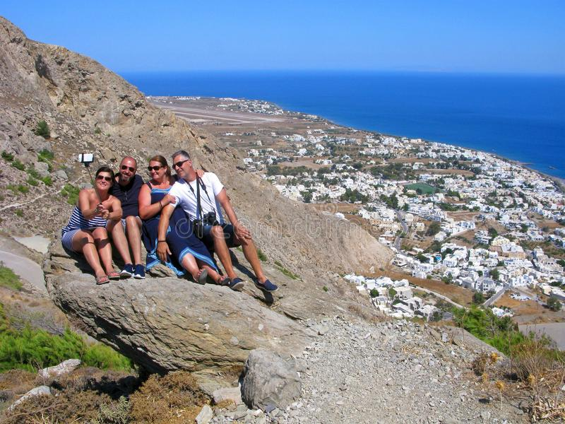 Smiling people, Greece, Santorini, selfie, top view of Kamari beach stock photo