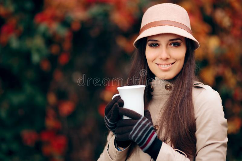 Happy Woman Drinking Tea in Autumn Season royalty free stock images