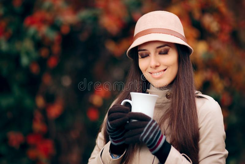 Happy Woman Drinking Tea in Autumn Season stock photo