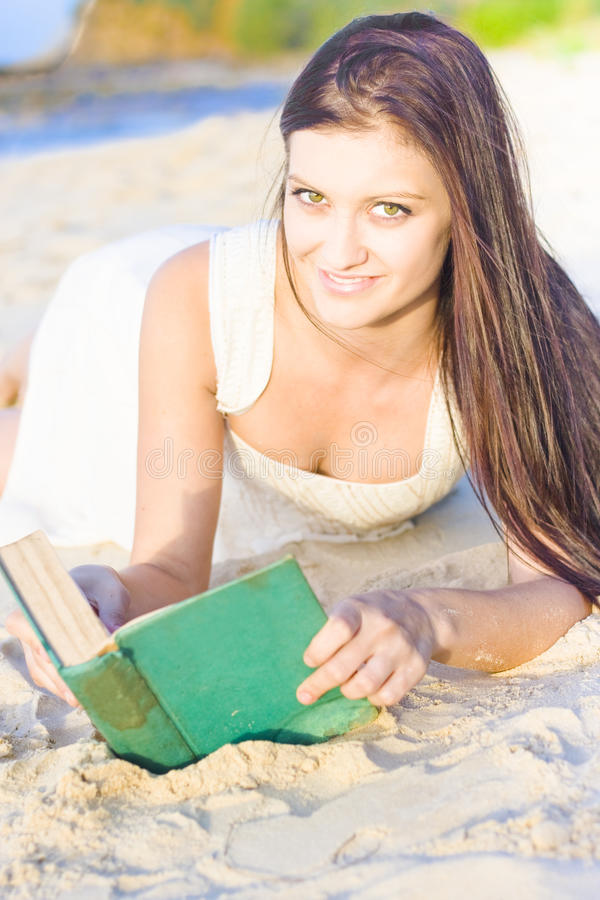 Download Smiling Person Relaxing With Book Stock Image - Image of beautiful, interest: 19892305