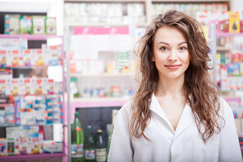 Smiling Pharmacist at her work place. Healthcare business. Medical business stock image
