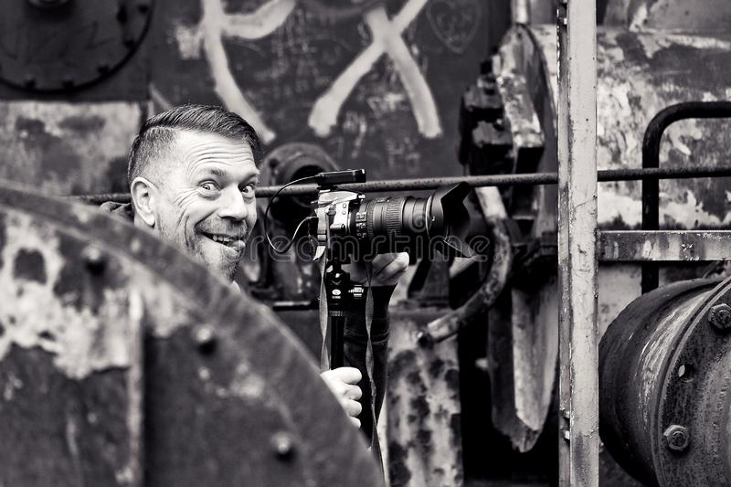 Smiling photographer in industrial setting