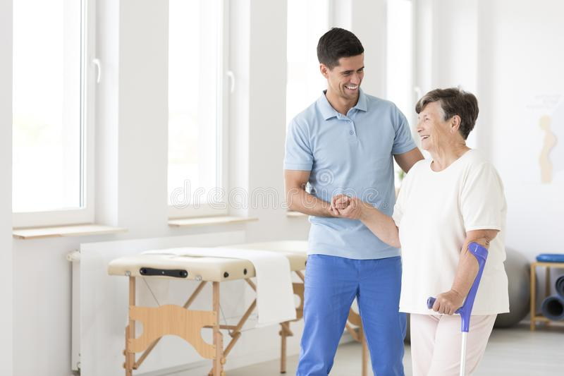 Disabled senior woman during rehabilitation stock images
