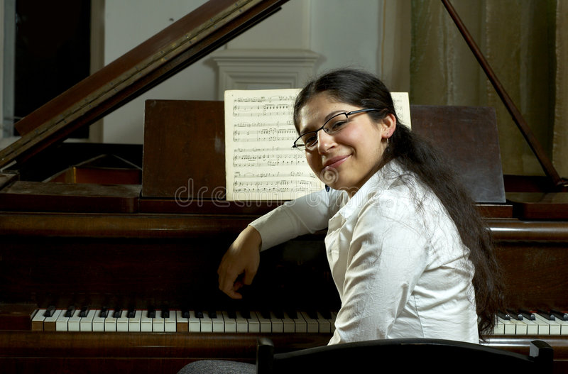 Smiling Piano Teacher royalty free stock photography