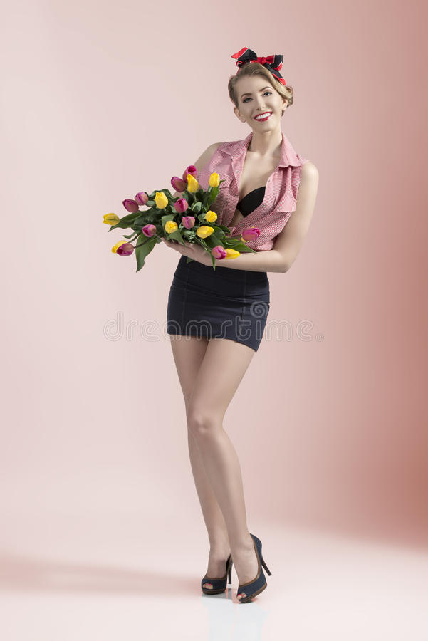 Smiling Pin-up With Coloured Flowers Royalty Free Stock Images
