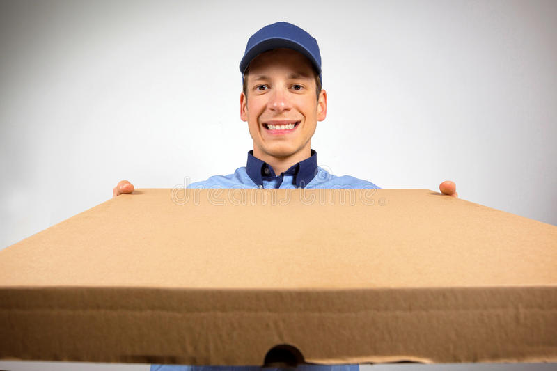 Smiling pizza delivery man holding pizza box. Smiling pizza delivery man, holding pizza box stock photos