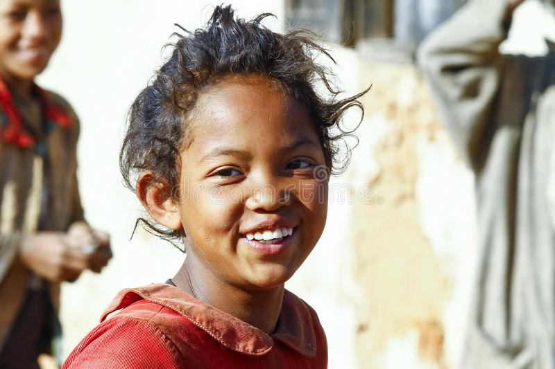 Smiling poor african girl, Africa stock photo