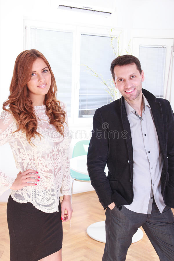 Smiling portrait of a female and male business executives at off. Ice or at home indoors royalty free stock photos