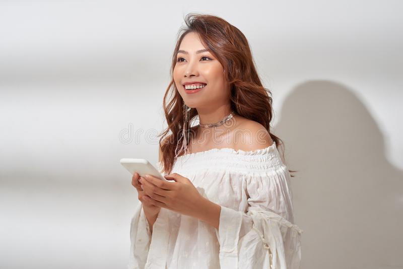 Smiling, positive asian woman with beautiful emotional face listening to music over white royalty free stock photos