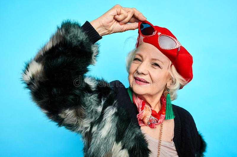 Smiling positive granny in trendy clothes looking at the camera stock photos