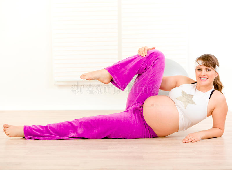 Smiling Pregnant Woman Doing Aerobics Exercise Royalty Free Stock Images