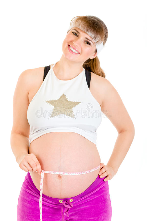 Download Smiling Pregnant Woman Measuring Her Belly Stock Photo - Image: 17738770