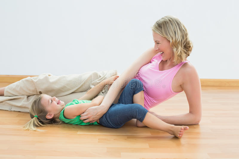 Download Smiling Pregnant Woman Tickling Young Daughter Stock Image - Image of sporty, side: 39218363