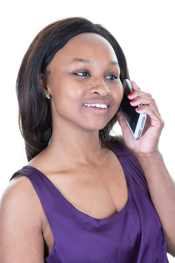 Smiling pretty African American woman on the cell phone stock photos