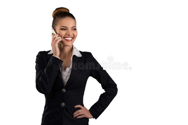 Smiling pretty businesswoman talks on the phone isolated on white royalty free stock photography