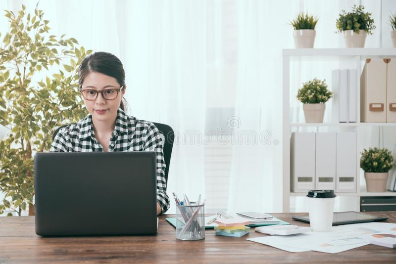 Smiling female soho office worker working at home royalty free stock photos