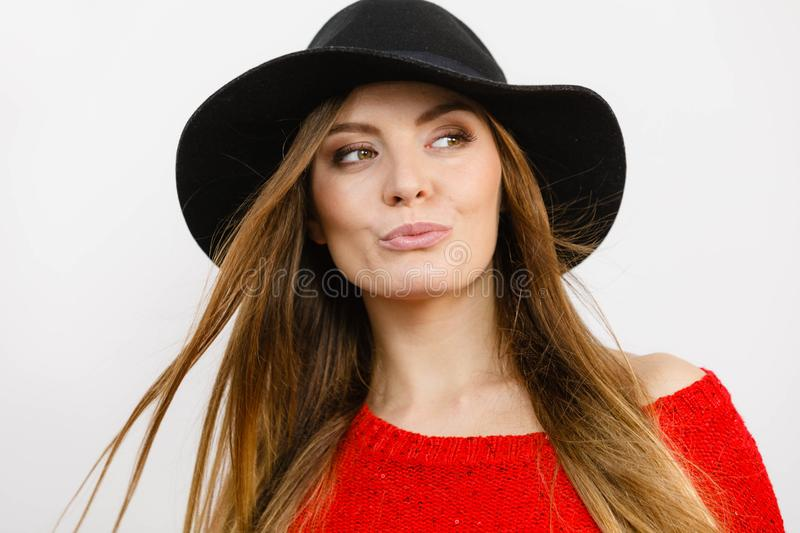 Smiling pretty girl with brown hair and black hat stock images