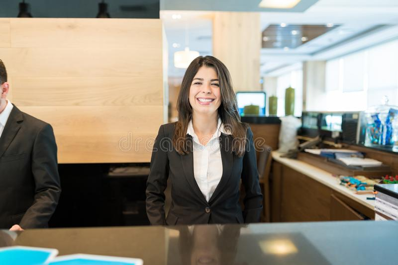 Smiling Pretty Manager At Hotel Reception royalty free stock image