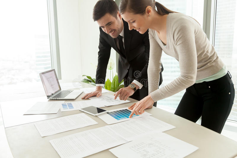 Smiling professional designers working on project, residential i royalty free stock photography