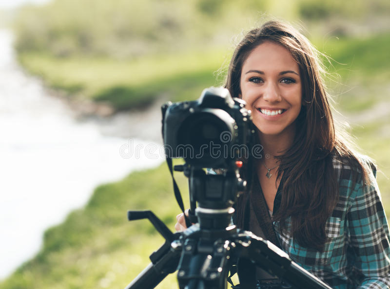 Smiling professional photographer royalty free stock photography