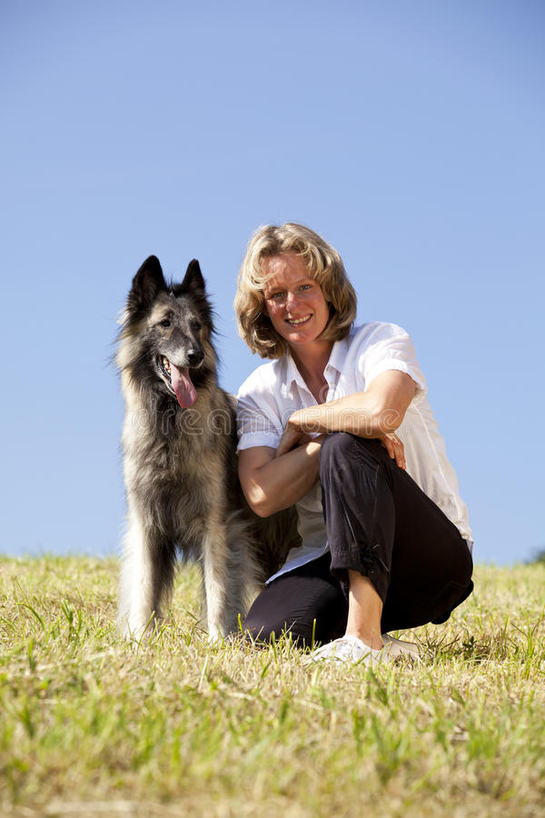 Download Smiling And Proud Woman With Belgian Shepherd Stock Image - Image: 14908045
