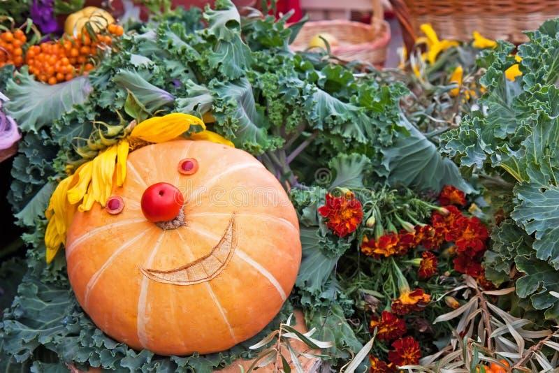 Smiling pumpkin on a harvest festival stock image