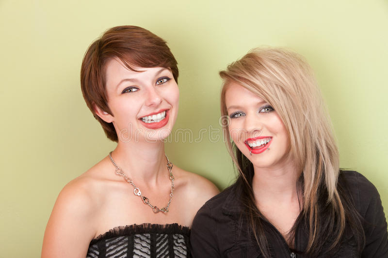 Smiling Punky Looking Teens Royalty Free Stock Photos