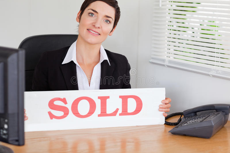 Download Smiling Real Estate Agent With A Sold Panel Royalty Free Stock Photography - Image: 20361497