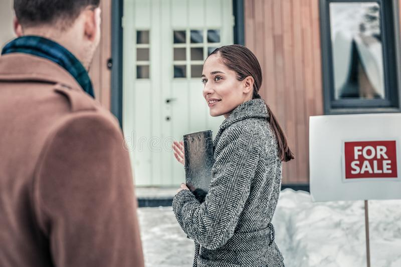 Estate agent meeting her clients before presentation stock image