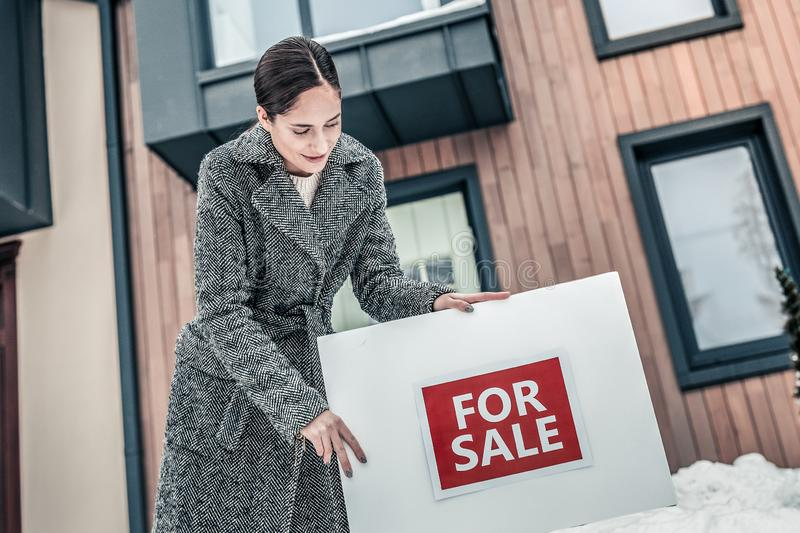 Smiling realtor offering a house for sale royalty free stock photo