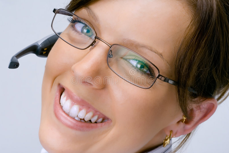 Smiling Receptionist #2. A smiling happy receptionist with telephone headset. She has beautiful flawless skin and teeth. Her smile greets customers and she is stock images